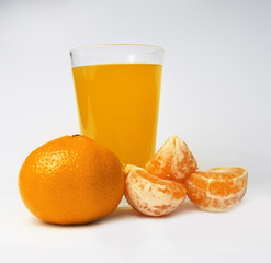 Tangerine and glass of juice 2