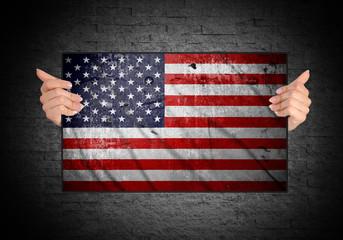 hand holding flag of usa