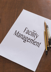 Facility management writen on paper
