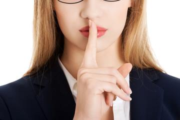 Woman making silent gesture