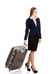 Young businesswoman holding travel bag