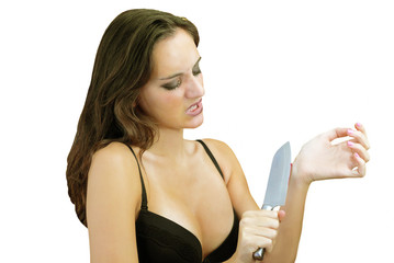 Woman suicidal act with knife on wrist