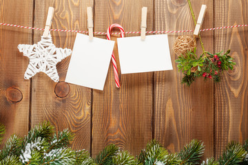 Snow fir tree, photo frame and christmas decor on rope