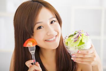 beautiful girl eating healthy food
