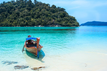LIPE, SATUN, THAILAND - SEP 27, 2014: Fisherman sailed longtail
