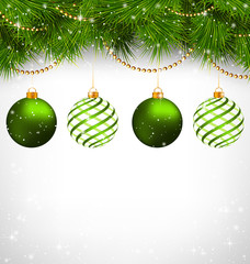 Two green and two spiral Christmas balls on green pine branches