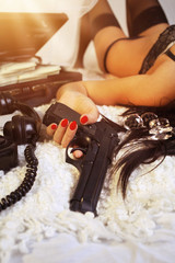Girl in lingerie with gun and money