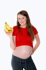 young pregnant woman with bananas