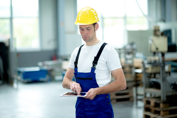 worker in factory using tablet pc