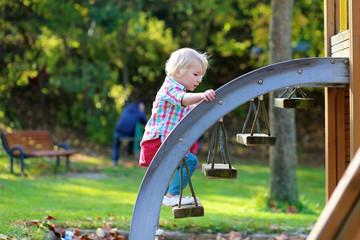Toddler girl enjoying playground