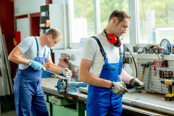two worker on work bench