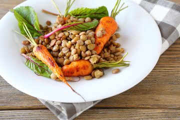 green lentils and roasted young carrots