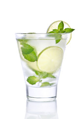 small glass with lemonade, ice, mint and lime. Isolated on white