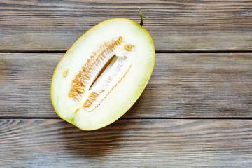 half ripe melon on wooden background