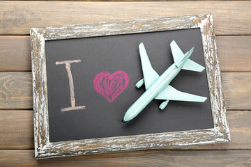 I love travelling by airplane written on chalkboard, close-up