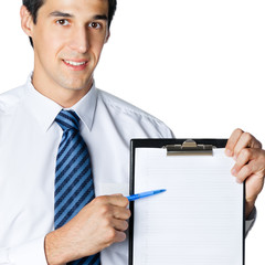 Businessman showing clipboard, isolated