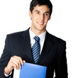 Smiling young businessman with blue folder, isolated