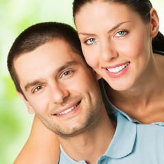 Happy smiling attractive couple, outdoor