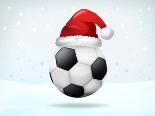 football ball covered with Santa cap