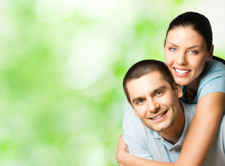 Portrait of young happy couple, outdoor