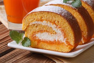 dessert of carrot roll with cream closeup