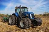 Modern farm tractor with planter - 72396623