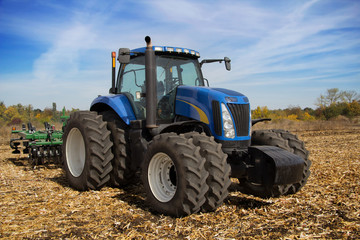 Modern farm tractor with planter
