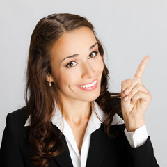 Businesswoman showing blank area for sign