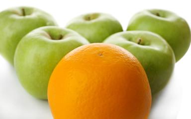 Juicy apples and orange, close-up