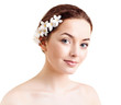Beautiful woman with flowers in her hair and pure skin