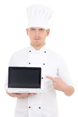 young man in chef uniform holding laptop with empty screen isola