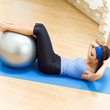 Woman with fit ball at home