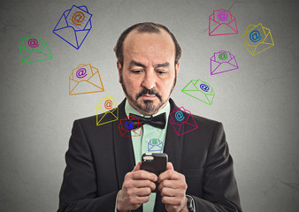 man sending message email icons flying from smartphone