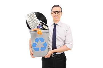 Man holding a recycle bin with bunch of old stuff