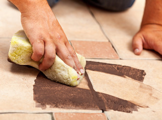Phases of installing ceramic floor tiling - the joint material
