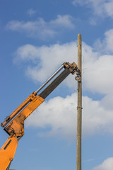 wooden telephone pole hangs vertically 2