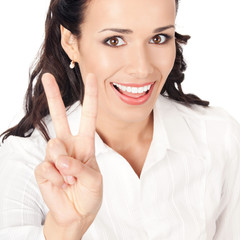 Businesswoman showing two fingers, on white