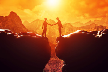 Two men shake hands over precipice. Business