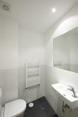 Bathroom interior with white ceramic walls