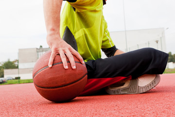 Young man on basketball court. Dribbling with ball