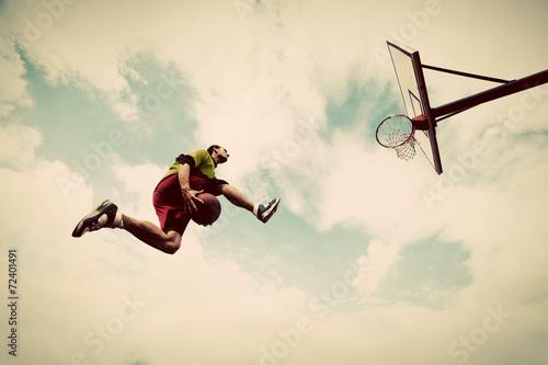 Young man making slam dunk playing streetball, basketball - 72401491
