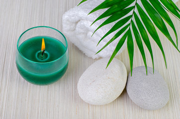 Spa decoration with candle and spa stones