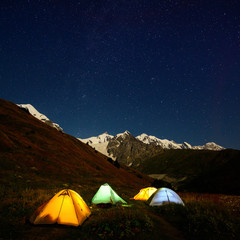Night camping in the Caucasus valley near Shkhara in Georgia