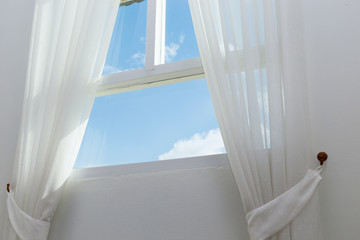 white curtain on the window with blue sky