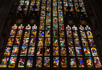 Colorful stained-glass windows in Duomo (Cathedral) in Milan.