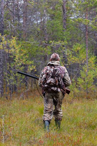 Fotobehang Jacht hunter shooting on the forest edge