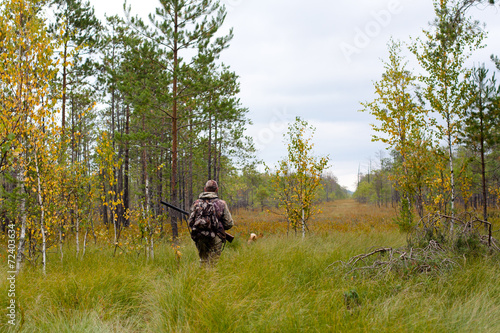 Fotobehang Jacht hunter walking on the glade