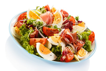 Boiled eggs with smoked ham and vegetables