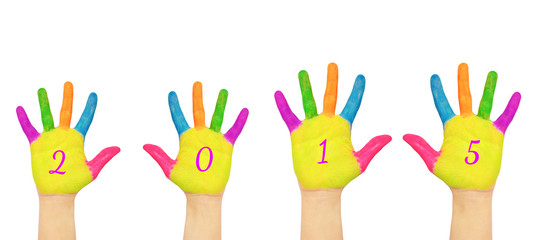Children hands forming number 2015.