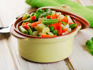 Mixed vegetables in a bowl on  wooden table